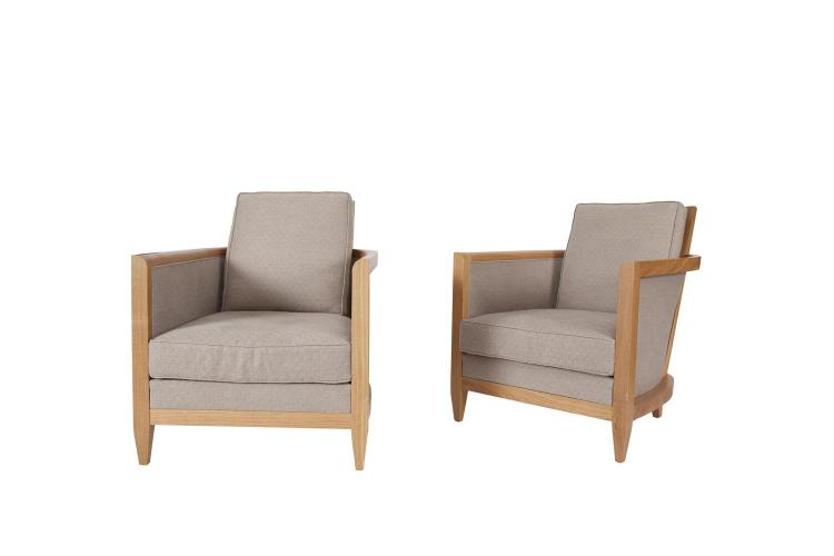 A PAIR OF OAK FRAMED UPHOLSTERED ARMCHAIRS, with raised back panel, with loose back and seat cushions, covered in grey diamond motif fabric and raised on square tapering short legs. 70cm wide x 84cm deep x 82cm high