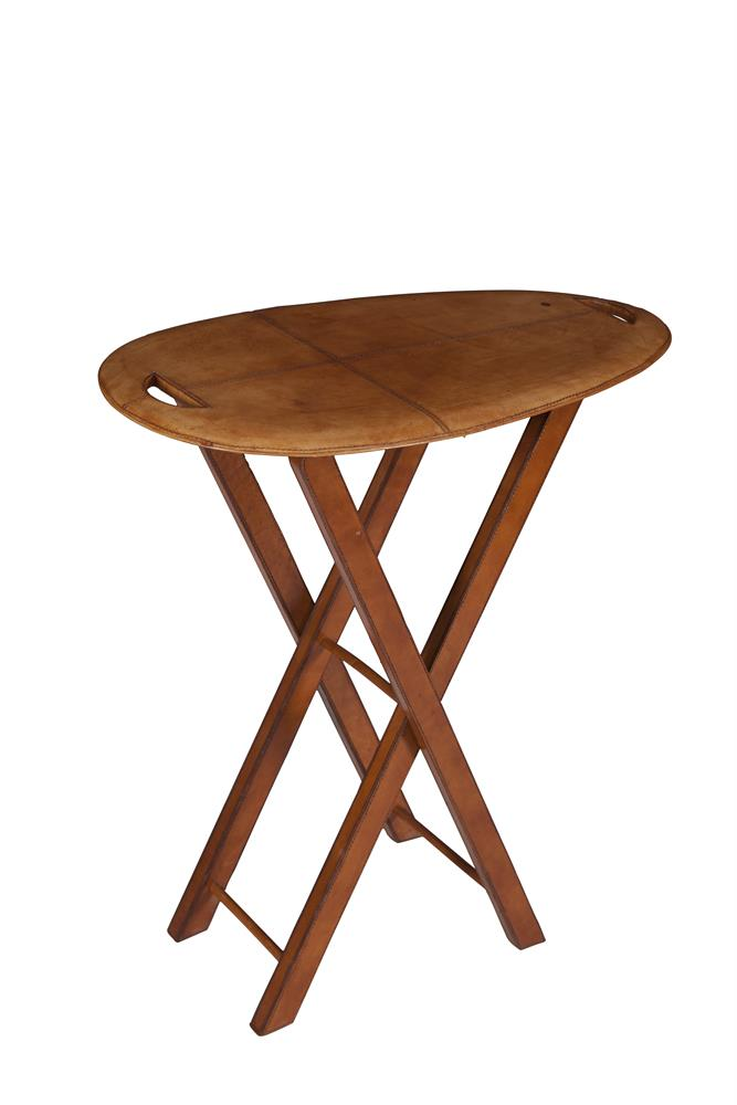 A MODERN LEATHER COVERED OVAL OCCASIONAL TABLE, with stitched decoration and raised on folding 'X' supports. 69 x 40 x 74cm