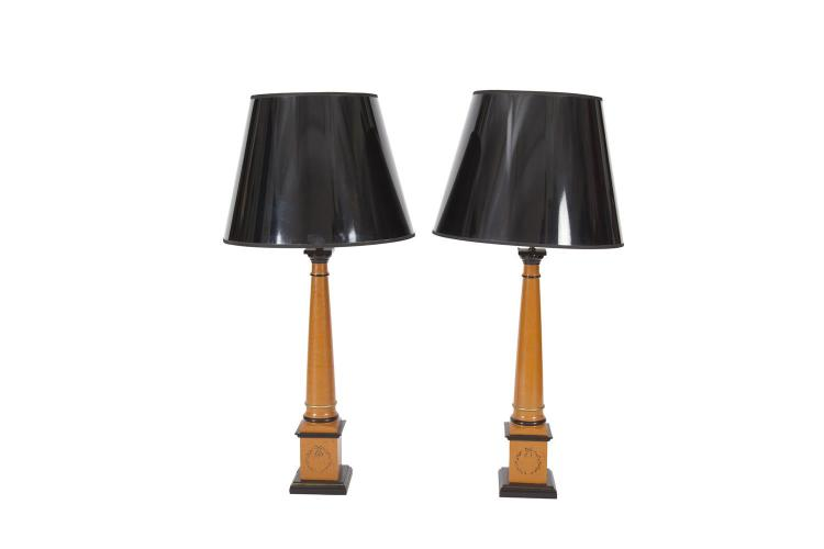 A PAIR OF TALL TABLE LAMPS AND SHADES, the bronze painted circular tapering columns raised on square plinths and ebonised base, with glossy black paper shades with burnished gilt interiors. 62cm high x 99cm high overall