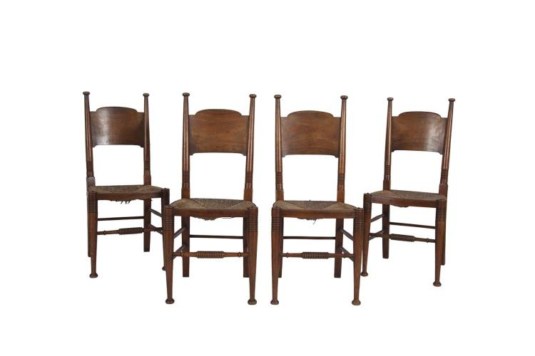 A SET OF FOUR NORDIC STAINED WOOD FRAMED SIDE CHAIRS, with rush seats, the tall rail backs joined by deep splats and with ring bound decoration, raised on turned tapering legs and stretchers
