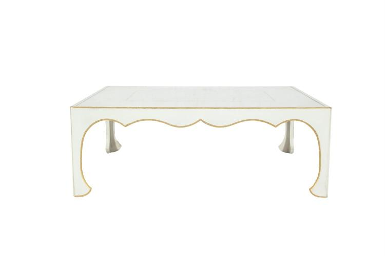 AN IVORY PAINTED TIMBER RECTANGULAR COFFEE TABLE, the top with gold banding and with inset plate glass, within a moulded and parcel gilt border, raised on Moorish style shaped apron and curved legs. 91.5 x 122 x 44cm high