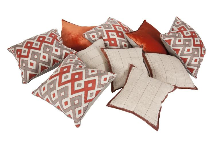 A COLLECTION OF TEN QUALITY CUSHIONS, comprising four with geometric pattern fabric by Mark Gillette, two 'de Le Cuona' burnt orange silk velvet and linen and a set of four 'de Le Cuona' kid leather trimmed linen cushions. (10)