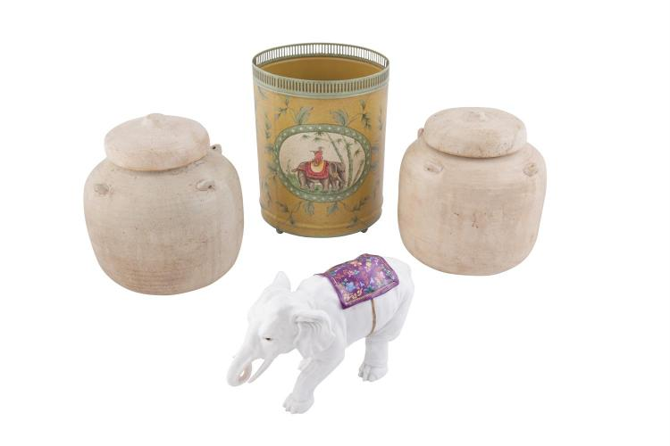 A PAIR OF THAI POTTERY COVERED JARS, of circular form, finished with a crackleware glaze; together with a white glazed porcelain model of an elephant; and a tôle waste paper bin with elephant decoration (4)