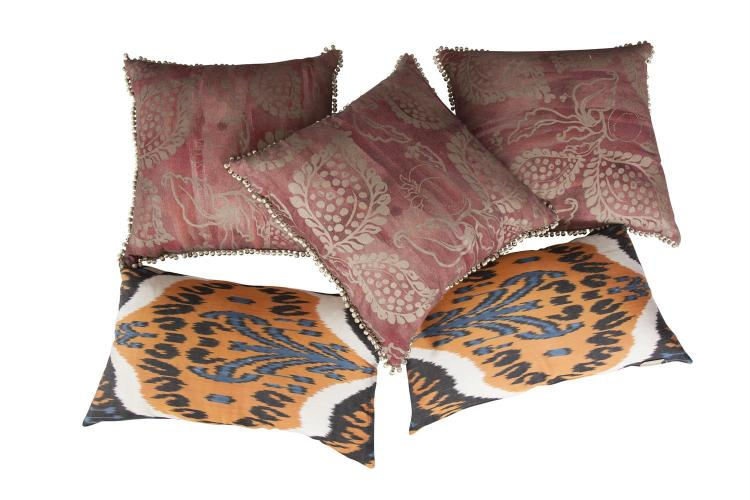A PAIR OF LONG CUSHIONS, Yastik by Rifat Orbek; together with a set of three cushions by Mark Gilette. (5)