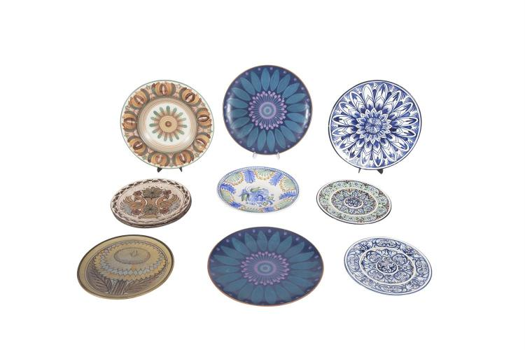 A COLLECTION OF TEN MODERN CONTINENTAL MAJOLICA AND OTHER POTTERY CHARGERS, various sizes and designs. (10)
