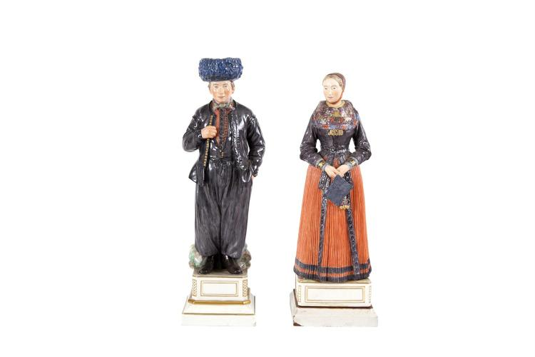 TWO ROYAL COPENHAGEN POLYCHROME PORCELAIN FIGURES BY CHARLES MARTIN-HANSEN FROM HIS 'NATIONAL COSTUMES OF DENMARK' SERIES 1906-1925(i) RC Acht Pitter Bacher's daughter    - Church Going Costume, Amager, 30cm high;(ii) RC Dirch Jan Isbrandtsen