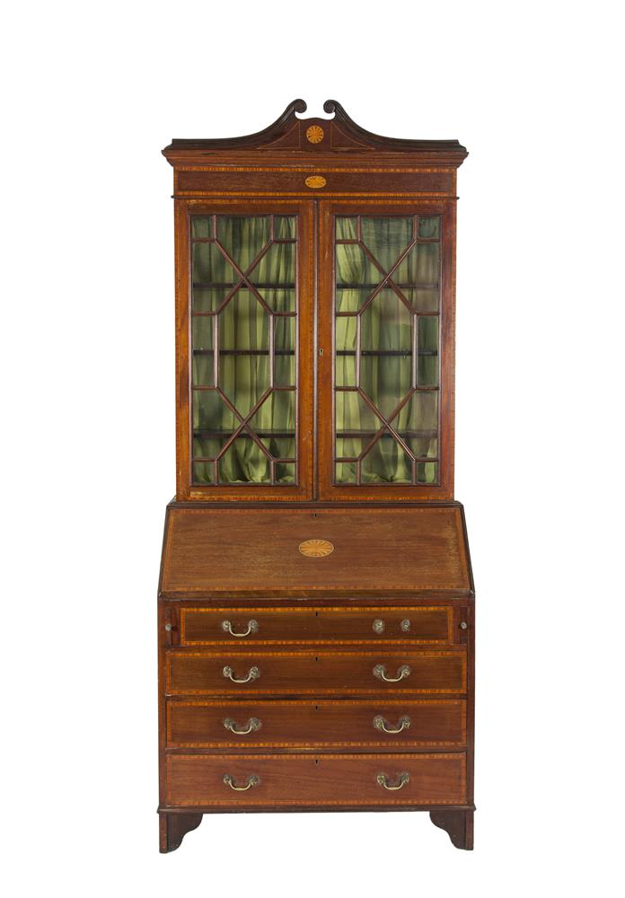 AN EDWARDIAN INLAID MAHOGANY BUREAU BOOKCASE, with moulded cornice above twin astragal glazed panel doors on a base with fall front and fitted interior above four long drawers and raised on bracket feet