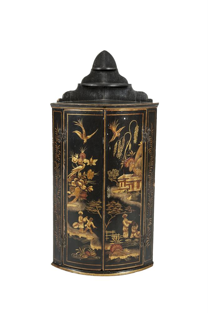 A GEORGE III LACQUERED HANGING CORNER CABINET, decorated with chinoiseries against an ebonised ground. 92cm x 56cm