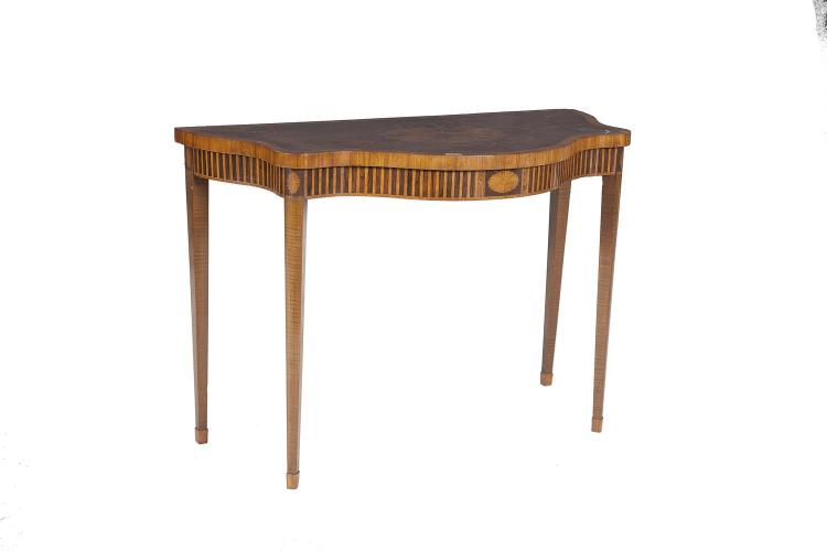 A 19TH CENTURY GEORGE III STYLE INLAID MAHOGANY SERPENTINE FRONT SIDE TABLE, the top inlaid with oval patera trailing bellflowers and anthemions, on a fiddleback mahogany ground, within satinwood banding, above a fluted inlay frieze, on square taperi