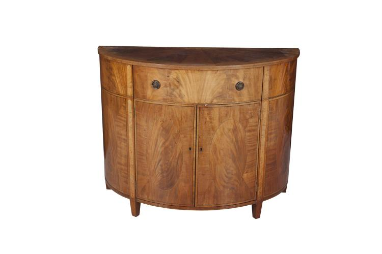 A GEORGE III STYLE INLAID SATINWOOD HALF CIRCULAR COMMODE, fitted single frieze drawer above twin panel door cupboard with boxwood stringing and raised on square tapering legs. 114cm wide