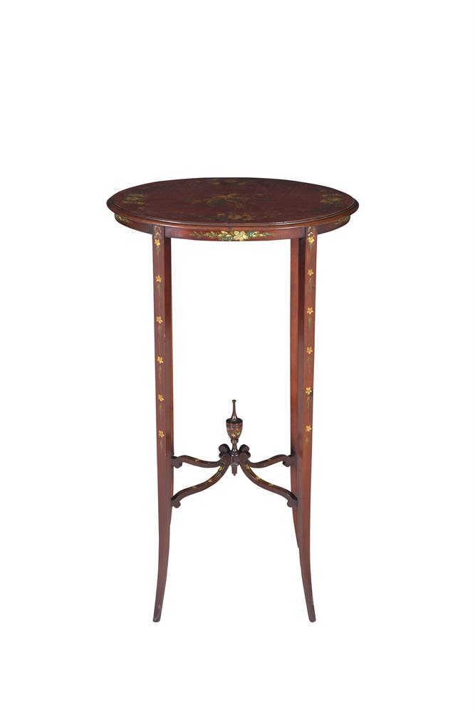 AN EDWARDIAN MAHOGANY OVAL OCCASIONAL TABLE, of slender proportions raised on square splayed legs and 'X' supports with central urn. 40cm wide x 26cm