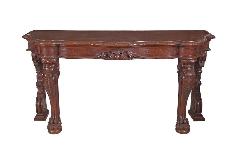 A VICTORIAN MAHOGANY SERPENTINE FRONT SERVING TABLE, the top with heavily carved rosette and ribbon boarder, a similarly carved frieze and raised on heavy carved legs, with paw feet. 184 x 66cm, 91cm high