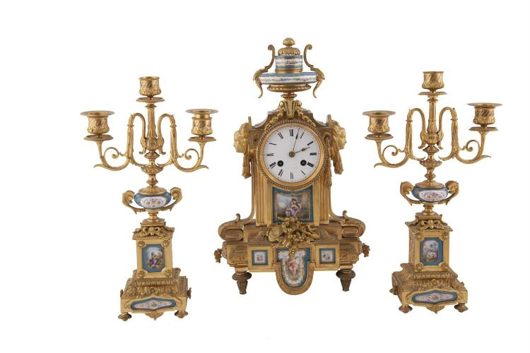 A FRENCH LOUIS SEIZE STYLE GILT BRASS CASED THREE PIECE CLOCK SET, with Sevres style panels and white enamel dial, 42cm high, the side ornaments with three candle sconces. 36cm high