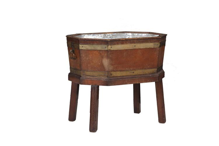 AN OCTAGONAL WINE COOLER, with zinc liner fitted with twin side handles and raised on slightly splayed legs. 54 x 39