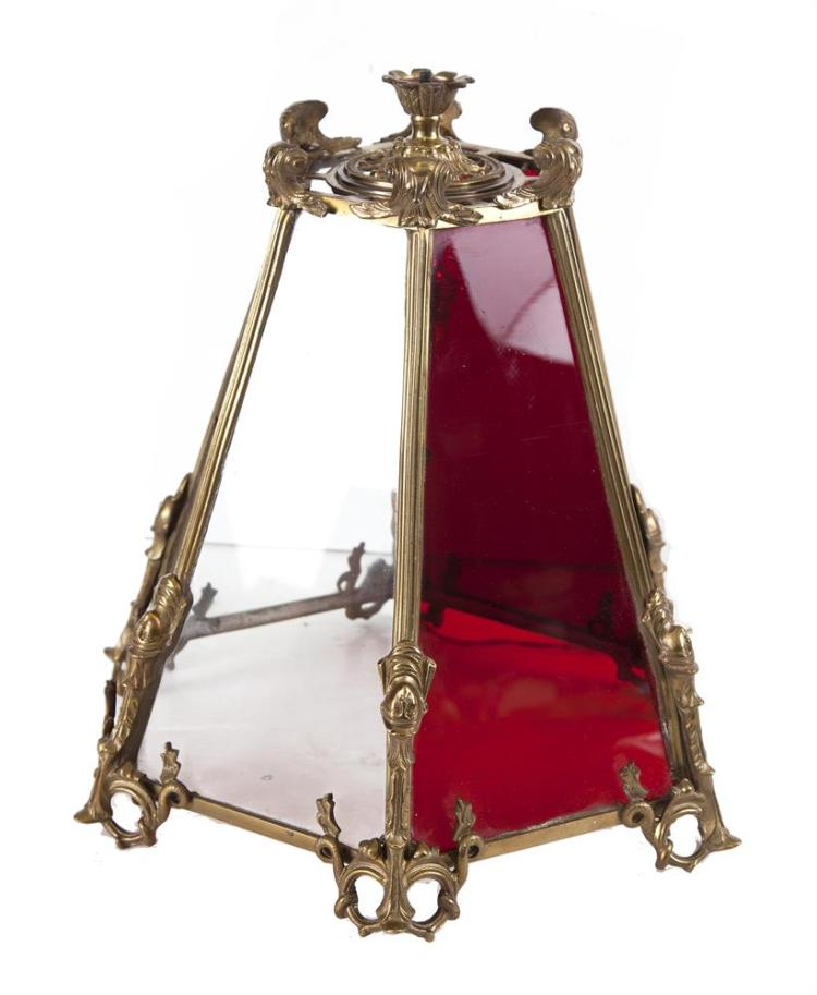 A GEORGIAN STYLE BRASS FRAMED RUBY AND CLEAR GLASS HALL LANTERN, of panelled tapering form, supported on suspension ring and chains. c.100cm high