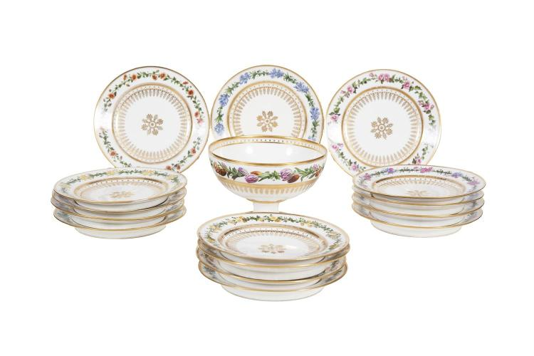 A SEVRES PORCELAIN PART DESSERT SERVICE, comprising fourteen plates and a circular pedestal fruit bowl, the white ground decorated with floral border and gilded tracery to reserves. (15)