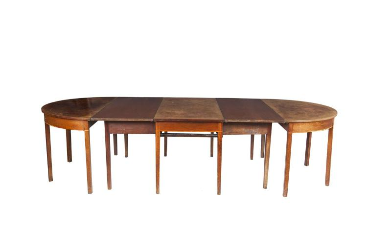 A 19TH CENTURY PALE MAHOGANY THREE PART ECONOMY DINING TABLE, with twin D-ends and centre section raised on square supports, together with two extra leaves. 300cm long x 130cm wide