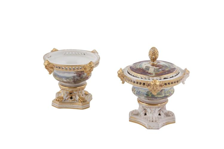 A PAIR OF CROWN DERBY PORCELAIN POT POURRI VASES, of circular form with painted landscapes and parcel gilding, having one lid with pineapple finial. 11cm high (distressed)