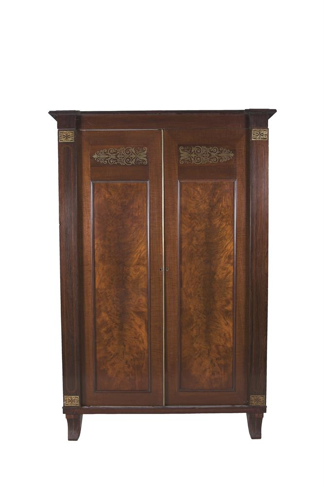 AN EARLY 19TH CENTURY MAHOGANY AND BRASS INLAID TWO DOOR WARDROBE, with recessed flame mahogany panels, with fiddle back borders and brass anthemion decoration, the interior with linen drawers and chest on splayed feet. 208cm high x 143cm wide