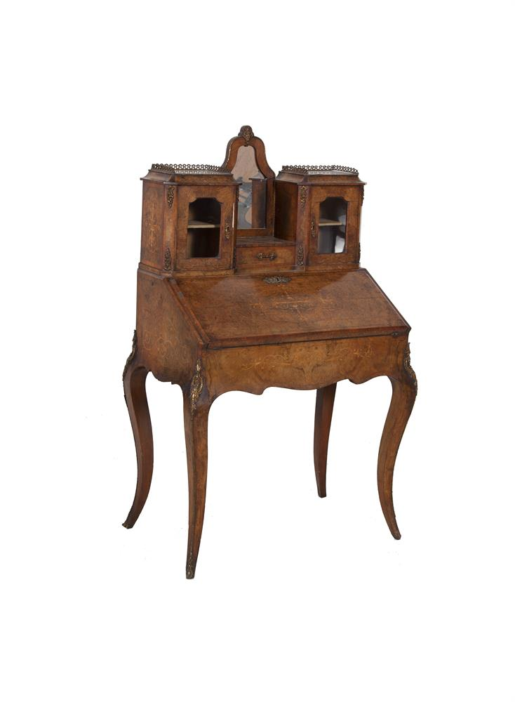 A WALNUT AND MARQUETRY BUREAU DE DAME, late 19th century, the mirrored superstructure with glazed cabinets, slope front concealing a fitted interior, above a shaped apron on cabriole legs, with gilt metal trim and mounts throughout. 87cm wide x 142cm