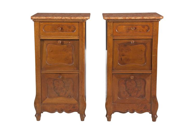 A PAIR OF CONTINENTAL WALNUT BEDSIDE COMMODES, on moulded bases with marble tops. 81cm high x 43cm wide x 35cm deep