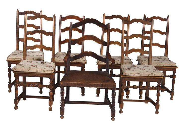 ***WITHDRAWN***A SET OF SIX COUNTRY-MADE TALL LADDER-BACK FRUITWOOD CHAIRS, 19th century, with solid seats, and a similar associated armchair