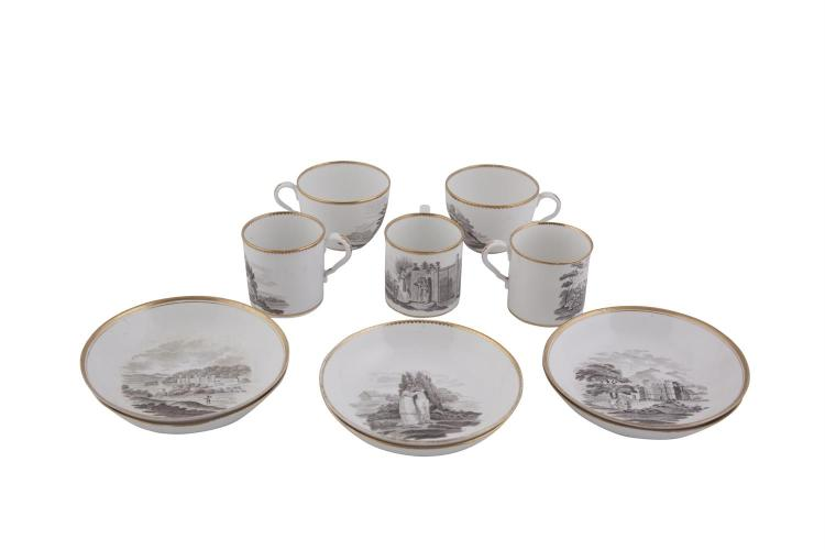 A SPODE PART TEA/COFFEE SET, early 19th century, comprising six saucers, three cylindrical coffee cups and two tea cups, with gilded rims and printed decoration depicting monochrome scenes of landscapes, animals and figures. (11)