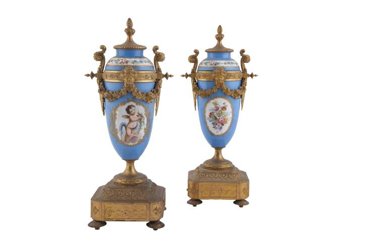 A PAIR OF FRENCH PAINTED PORCELAIN URNS, 19th century, with gilt metal mounts. 37cm high