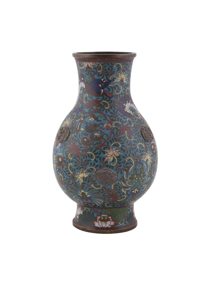 A CHINESE QING PERIOD CLOISONNÉ VASE, 19th century, in late Ming style, the baluster body decorated with a  dragon in blue enamel against a turquoise ground, on a waisted circular foot. 26cm high