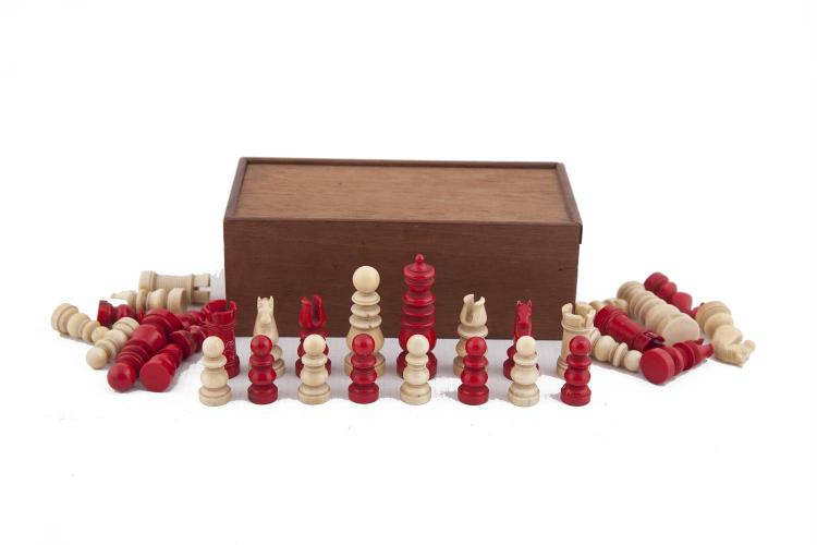 AN EARLY 19TH CENTURY ENGLISH IVORY CHESS SET, one side stained red, the other side left in natural white. The Kings 6.3cm highPLEASE NOTE: THIS ITEM CONTAINS OR IS MADE OF IVORYBidders should be advised that importation regulations of several cou