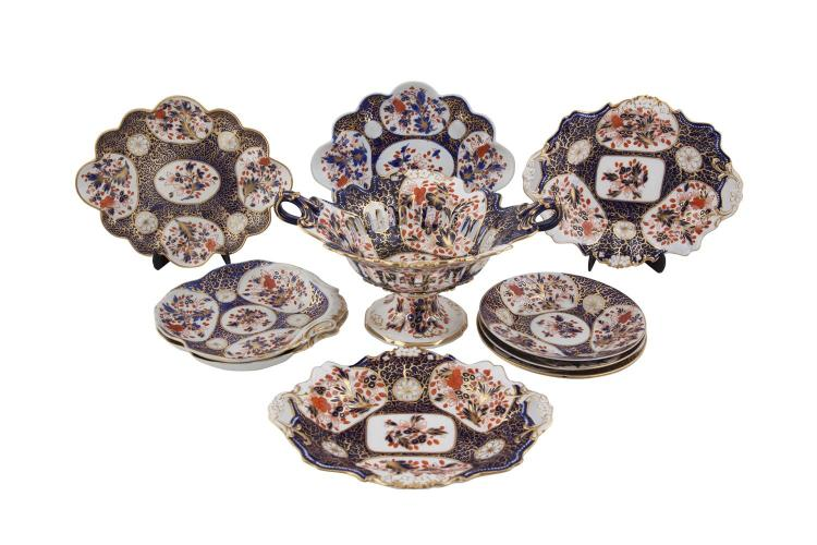 A COMPOSED ENGLISH CHINA PART TEA SERVICE, the decoration inspired by Imari patterns, comprising nine various plates and dishes and a pedestal fruit dish. (11)