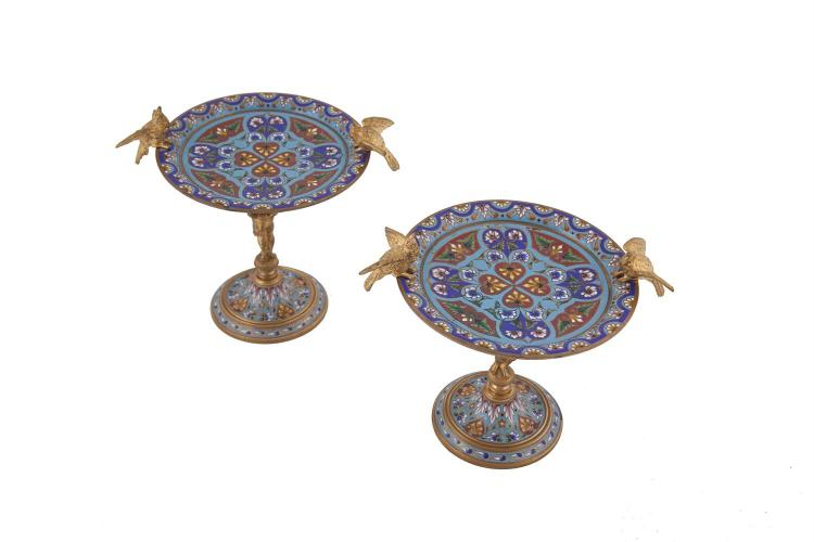A PAIR OF FRENCH ORMOLU AND ENAMEL TAZZAS, of circular form, each modelled in the style of a bird bath with shallow dished top applied with bird models to each side, supported on a figural column and spreading circular base. 19cm high