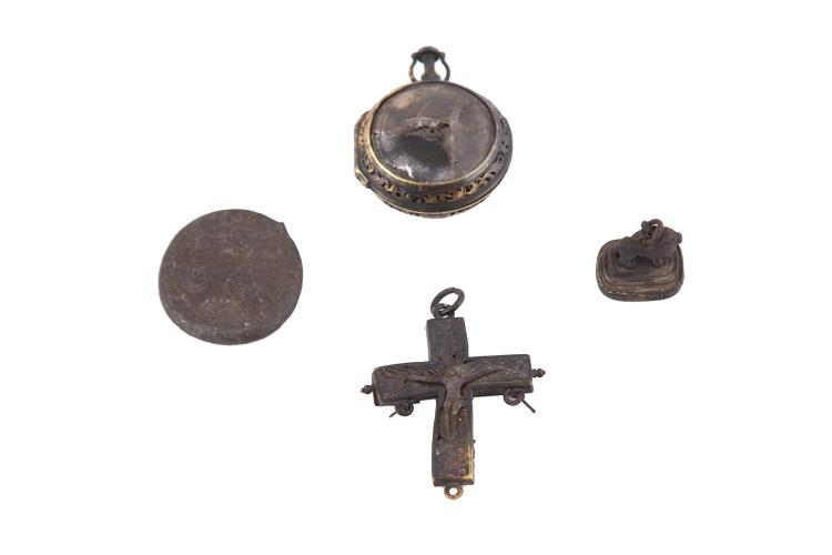 AN INTERESTING COLLECTION OF FIRE DAMAGED METAL, SILVER AND GOLD ITEMS RELATING TO CURRAGH HOUSE, including the seal of Sir Aubrey DeVere, a silver medallion, a Charles II figural gilt metal cross and a 18th century gold pocket watch reputed to have
