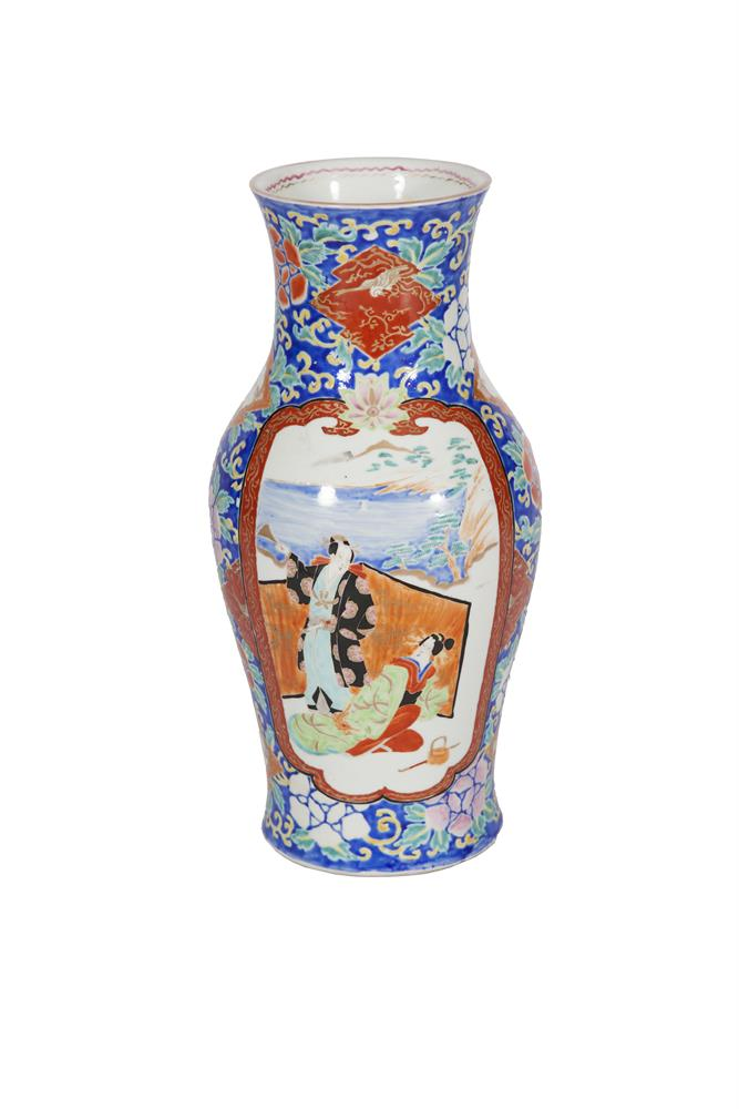 A JAPANESE BALUSTER SHAPED PORCELAIN VASE, 19TH /20TH CENTURY, decorated with figures dressed in kimonos on a coastline against a blue floral painted ground, the base with six character mark in red. 37.5cm high