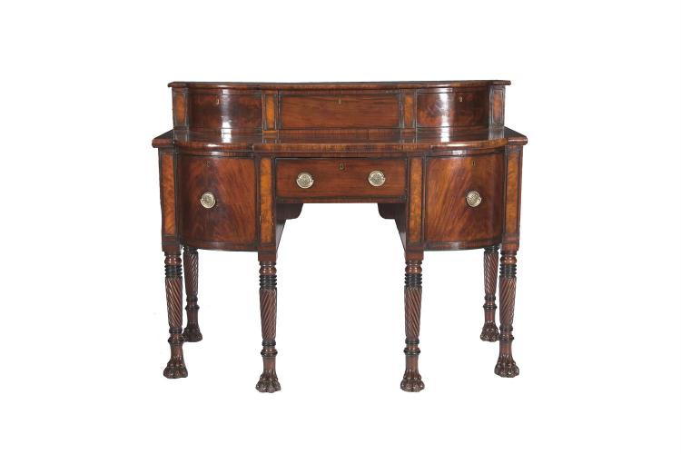 AN IRISH GEORGE III MAHOGANY SIDEBOARD, of bowfront outline, the shaped top with conforming superstructure fitted with slide door central compartment above a short frieze drawer and twin cupboard drawers, on spiral turned tapering legs and bold paw f