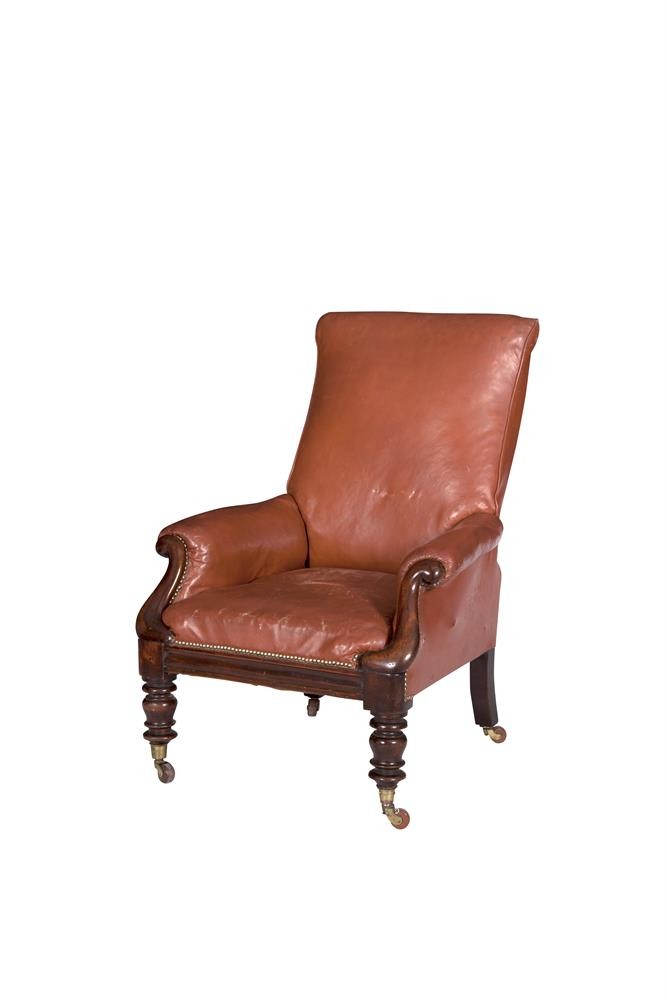 A WILLIAM IV BROWN LEATHER UPHOLSTERED ARMCHAIR, with square frame and mahogany scroll arm supports, raised on turned legs with casters. 79cm wide