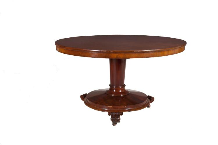 A VICTORIAN MAHOGANY TILT TOP BREAKFAST TABLE, c.1850, of circular form, the plain moulded top supported on a tapering centre column and circular platform base, with three scroll feet and castors. 128cm diameter