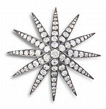 A LATE VICTORIAN DIAMOND STAR BROOCH, CIRCA 1980The twelve-rayed star set throughout with old brilliant, cushion and rose-cut diamond highlights, mounted in silver and gold, diamonds approximately 4.40cts total, width 4.5cm