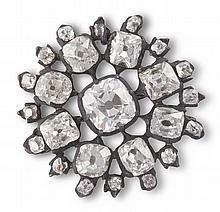 A DIAMOND BROOCH, SECOND HALF OF THE 19TH CENTURYA cushion-shaped diamond to the centre, to radiating spokes and border of similarly-cut diamonds, diamonds approximately 3.60cts total, length 2.3cm