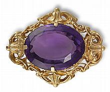 A 19TH CENTURY AMETHYST BROOCHThe oval mixed-cut amethyst, weighing approximately 27.50cts, within a scrollwork surround, width 4.3cm
