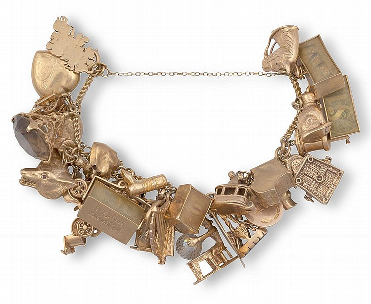 A GEM-SET AND GOLD CHARM BRACELETThe chain-link bracelet with security chain, suspending 30 assorted charms, including a heart-locket, a cat, a car, a map of Ireland, etc...mounted in 9K gold, weight approximately 141g total