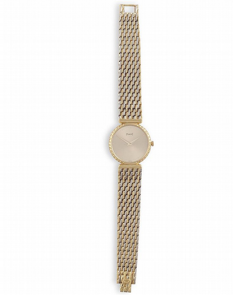 A LADY'S 18K GOLD MANUAL WIND BRACELET WATCH, BY PIAGET, CIRCA 1980The round-shaped case, sunburst champagne dial with outer dot minute divisions, polished lance hands, brushed and polished case with snap on reverse, integral woven link bracelet wit