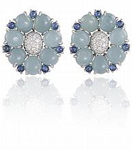 A PAIR OF AQUAMARINE, SAPPHIRE AND DIAMOND EARRINGS, BY SEAMAN SCHEPPSEach earring set with a brilliant-cut diamond bombé centre within a surround of aquamarine and sapphire cabochons, mounted in 18K gold, signed Seaman Schepps, numbered 17321, make