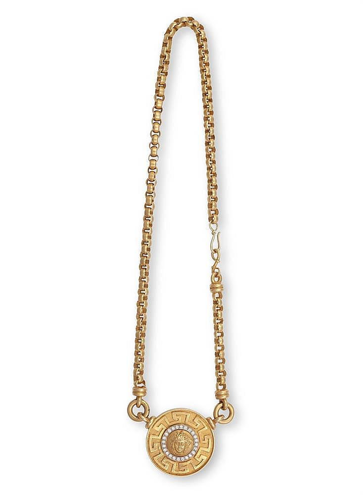 A GOLD AND DIAMOND PENDANT NECKLACE AND EARRINGS EN SUITEThe circular pendant depicting the head of Medusa, within a border of brilliant-cut diamonds, enclosed by a Greek key motif surround, suspended from a cable-link chain, the earrings designed e