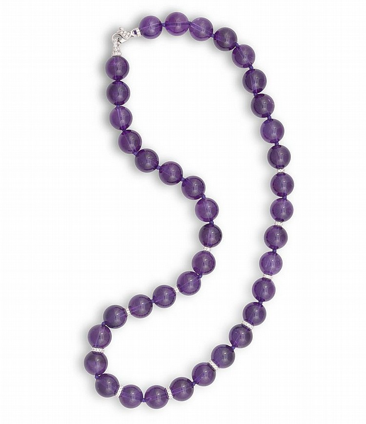 AN AMETHYST AND DIAMOND NECKLACE, BY MARGHERITA BURGENERComposed of 38 amethyst beads, interspersed with round brilliant-cut diamond links on front, with a similarly-cut diamond clasp, mounted in 18K gold, diamonds 1.41cts total, signed Margherita B