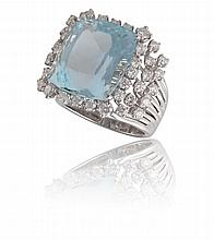AN AQUAMARINE AND DIAMOND RING, BY MARGHERITA BURGENERDesigned as a cushion-shaped aquamarine, weighing 15.47cts, within a round brilliant-cut diamond surround, mounted in 18K gold, diamonds 1.64cts total, signed Margherita Burgener, with maker's ca