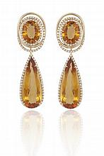A PAIR OF CITRINE AND DIAMOND PENDENT EARRINGS, BY MARGHERITA BURGENEREach surmount designed as an oval-shaped citrine, within a surround of orbiting rings, pavé-set with brilliant-cut diamonds, suspending a detachable pear-shaped citrine drop, with