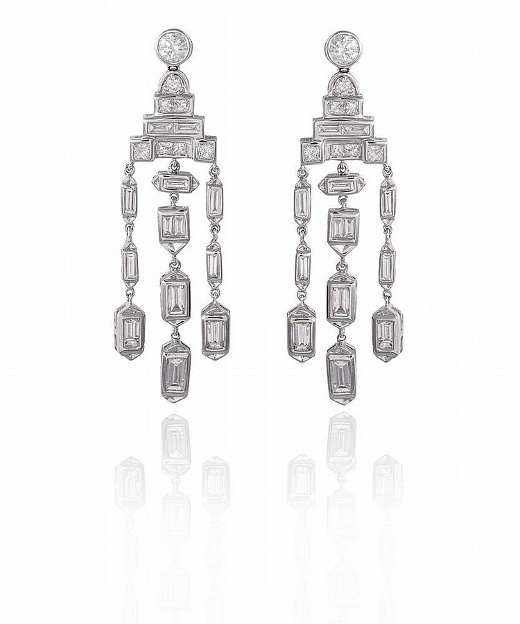 A PAIR OF DIAMOND CHANDELIER PENDENT EARRINGSOf chandelier design, each set throughout with round brilliant, square and baguette-cut diamonds, mounted in 18K gold, diamonds approximately 2.90cts total, French assay marks, length 4.8cm
