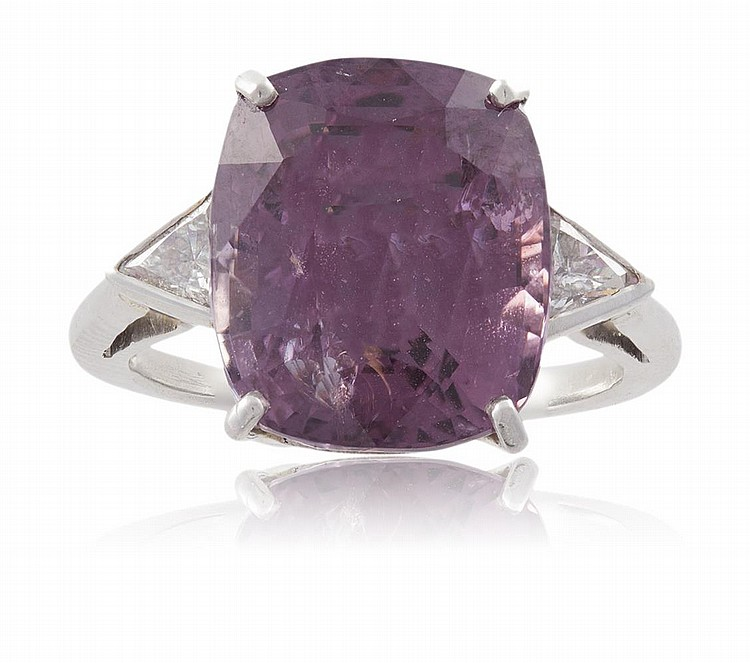 A SPINEL AND DIAMOND RINGThe cushion-shaped spinel within a four-claw setting, weighing 12.20cts, between two triangular-cut diamonds, mounted in platinum, Italian assay mark, ring size N½Accompanied by a report from GRS laboratory in Switzerland,