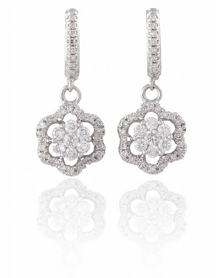 A PAIR OF DIAMOND PENDENT EARRINGSEach designed as a cluster highlighted by round brilliant-cut diamonds, suspended from a surmount of similarly-cut diamonds, mounted in 18K gold, diamonds approximately 0.70ct total, length 2.2cm